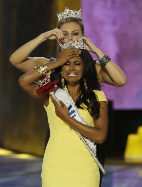Miss New York Nina Davuluri, front, is crowned as Miss America 2014 by Miss America 2013 Mallory Hagan, Sunday, Sept. 15, 2013, in Atlantic City, N.J. (AP Photo/Mel Evans)