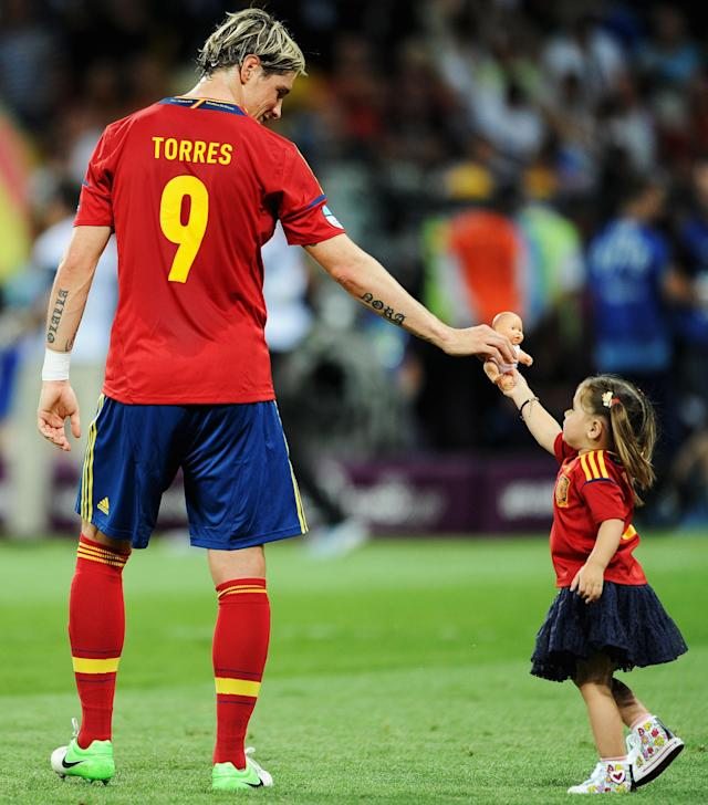 KIEV, UKRAINE - JULY 01: Fernando Torres of Spain hands a doll to his daughter Nora Torres after the UEFA EURO 2012 final match between Spain and Italy at the Olympic Stadium on July 1, 2012 in Kiev, Ukraine. (Photo by Jasper Juinen/Getty Images)