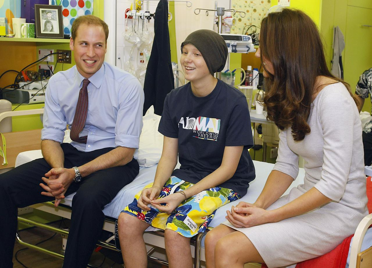 LONDON, UNITED KINGDOM - SEPTEMBER 29: Prince William, Duke of Cambridge and Catherine, Duchess of Cambridge meet patient Digby Davidson, 14,, during a visit to open the new Oak Centre for Children and Young People at The Royal Marsden Hospital on September 29, 2011 in London, England. (Photo by Kirsty Wigglesworth - WPA Pool /Getty Images)