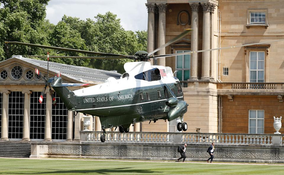 Presidential landing: Trump's Marine One helicopter comes in to land in the back garden of Buckingham Palace on Monday lunchtime. (Adrian DENNIS / AFP/Getty Images)