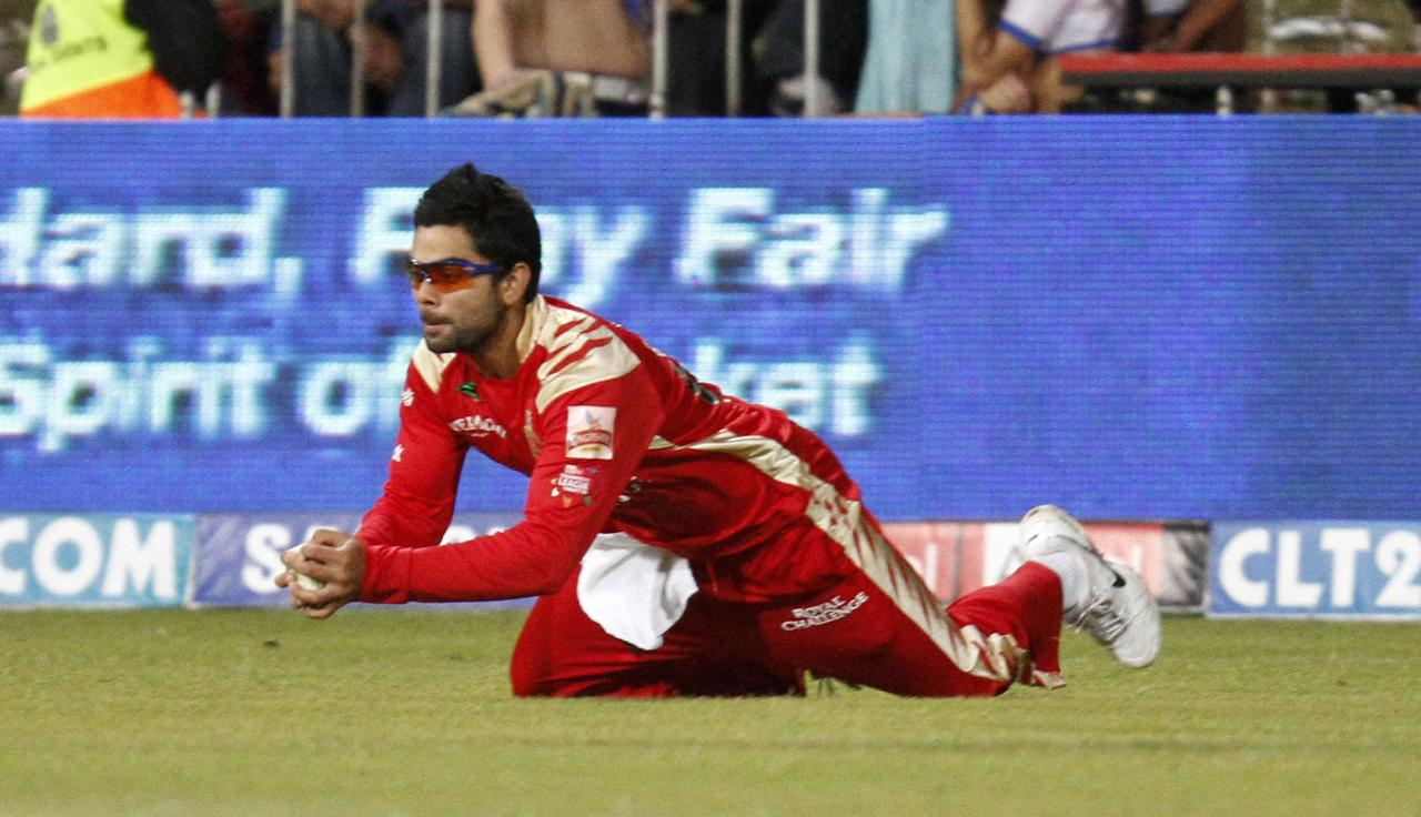 DURBAN, SOUTH AFRICA - SEPTEMBER 24:  Virat Kohli of Royal Challengers takes a catch during the Airtel Champions League Twenty20 semi final match between Chennai Super Kings and Royal Challengers Bangalore at Sahara Stadium Kingsmead on September 24, 2010 in Durban, South Africa (Photo by Anesh Debiky/Gallo Images/Getty Images)