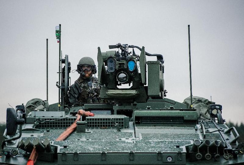 A soldier from the Swedish Armed Forces, looks on from top of a Patria XA-360 AMV at Hagshult Airbase near Malmo on November 6, 2014 (AFP Photo/Jonathan Nackstrand)