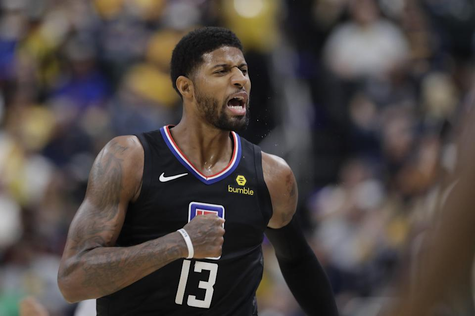 Los Angeles Clippers forward Paul George reacts after hitting a shot during the second half of an NBA basketball game against the Indiana Pacers, Monday, Dec. 9, 2019, in Indianapolis. The Clippers won 110-99. (AP Photo/Darron Cummings)