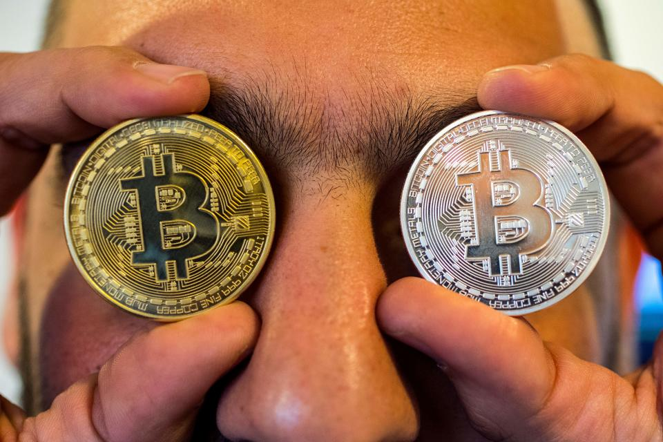 Moving fast: A person holds a visual representation of bitcoin at the 'Bitcoin Change' shop in the Israeli city of Tel Aviv. Photo: JACK GUEZ/AFP/Getty Images.
