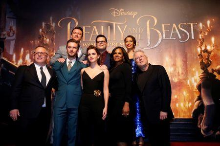 """Director of the movie Condon and composer Menken pose with cast members Stevens, Evans, Watson, Gad, McDonald and Mbatha-Raw at the premiere of """"Beauty and the Beast"""" in Los Angeles"""