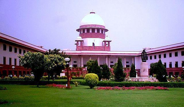 """In a landmark ruling, passed by a five-judge Constitution bench headed by former Judge Ranjan Gogoi, the Supreme Court ruled that the Chief Justice of India's (CJI) office is a public authority and will also come under the Right to Information Act. While making the judgement, the Court said, """"The Right to Information and Right to Privacy are two sides of the same coin. None can take precedence over the other,"""" and that """"Judicial independence and accountability"""" go hand in hand. This was a rare case of the SC ruling against itself as it had been fighting for 12 years to keep the CJI's office out of the RTI Act's ambit. This had been challenged by RTI activist Subhash Agrawal who had filed a petition calling for the office to be brought under RTI and made more transparent. <em><strong>Image credit:</strong></em> By Legaleagle86 - https://commons.wikimedia.org/wiki/File:Supreme_Court_of_India_-_200705.jpg, CC BY-SA 3.0, https://commons.wikimedia.org/w/index.php?curid=35020991"""
