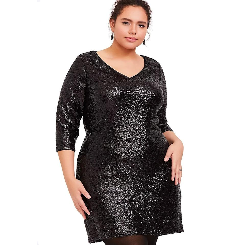 """Torrid gave the LBD a sequin update just in time for New Year's Eve. Pair this black sequined dress with semisheer tights for your night out—and scoop it up while it's on sale for 30% off. $99, Torrid. <a href=""""https://www.torrid.com/product/black-sequin-shift-dress/12292931.html#q=sequin&start=12"""">Get it now!</a>"""