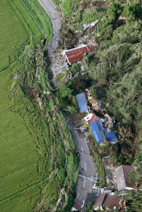 <em>This aerial photo shows houses destroyed by a landslide after an earthquake in Atsuma town (AP)</em>