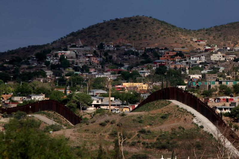 The US-Mexico border wall is seen near Nogales, Arizona, in 2012 (AFP Photo/Sandy Huffaker)