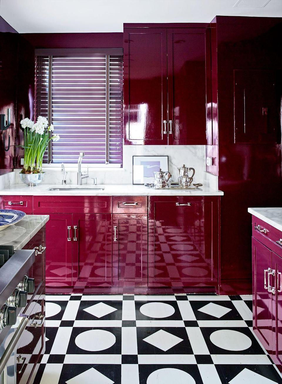 <p>Go glam with a high-gloss deep red reminiscent of wine. The robust, full color adds so much depth and glamour. Proof? This kitchen by Nick Olsen, where geometric tiles pump things up to the next level.</p>