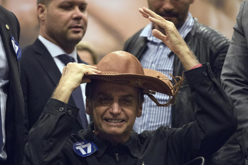 Presidential frontrunner Jair Bolsonaro, of the Social Liberal Party wears a traditional Brazilian cowboy hat during a press conference in Rio de Janeiro, Brazil, Thursday, Oct. 11, 2018. Bolsonaro will face Workers Party presidential candidate Fernando Haddad in a presidential runoff on Oct. 28. (AP Photo/Leo Correa)