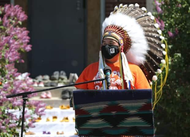 Federation of Sovereign Indigenous Nations Chief Bobby Cameron addresses the crowd during a prayer vigil honouring children who died while forced to attend residential schools.