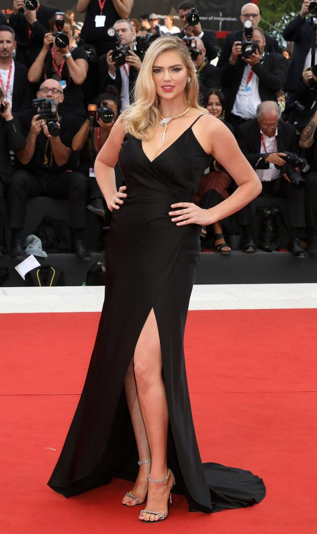Keeping things simple at the premiere of 'Marriage Story', model Kate Upton wore a black thigh-split Twinset gown accessorised with Jimmy Choo shoes and Bulgari jewels. <em>[Photo: Getty]</em>