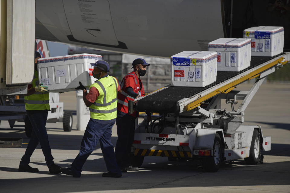 BELO HORIZONTE, BRAZIL - MARCH 17: CoronaVac vaccine boxes arrive at Belo Horizonte International Airport on March 17, 2021 in Belo Horizonte, Brazil. 509,800 CoronaVac vaccines arrive to continue to immunize health professionals and the elderly between 75 and 79 years old, in the state of Minas Gerais amid the coronavirus pandemic (COVID - 19). (Photo by Pedro Vilela/Getty Images)
