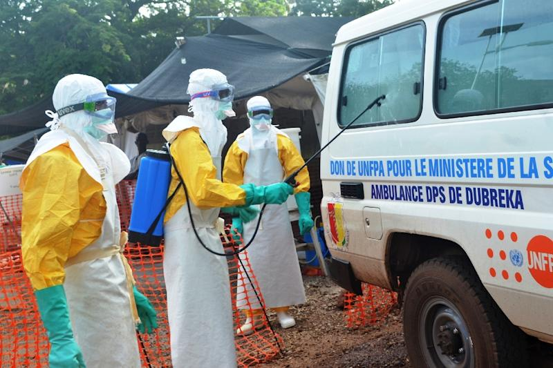 File picture shows health worker disinfecting a van at the Medecins Sans Frontieres (Doctors Without Borders) center in Conakry (AFP Photo/Cellou Binani)