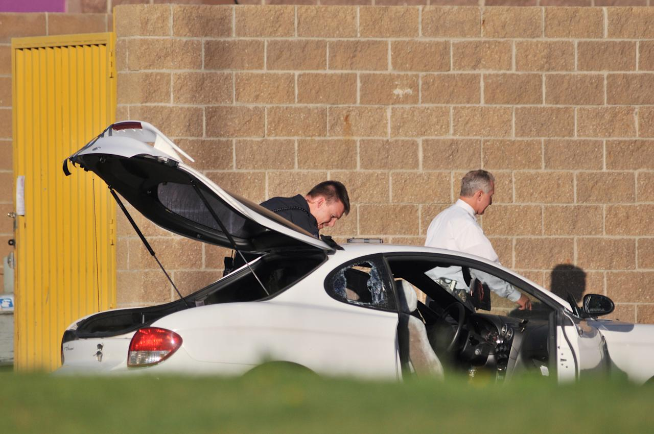 Police search what is believed to be the car of James Holmes, the suspect of a shooting in a movie theater, outside the Century 16 movie theater July 20, 2012 in Aurora, outside of Denver, Colorado. According to reports, 12 people have been killed and at least 38 wounded when James allegedly opened fire inside the a movie theater showing the 'The Dark Knight Rises.' Police have James, 24, of Holmes of North Aurora, in custody. (Photo by Thomas Cooper/Getty Images)