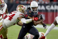 Arizona Cardinals wide receiver Larry Fitzgerald (11) is hit by San Francisco 49ers middle linebacker Fred Warner (54) during the second half of an NFL football game, Thursday, Oct. 31, 2019, in Glendale, Ariz. (AP Photo/Rick Scuteri)