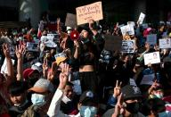 FILE PHOTO: Rally against military coup to demand release of elected leader Aung San Suu Kyi, in Yangon