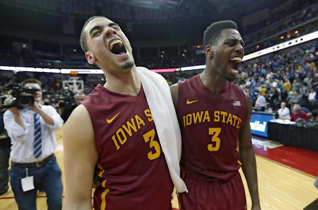 Iowa State's Georges Niang, left, and Melvin Ejim react after an NCAA college basketball game against Northern Iowa, Saturday, Dec. 7, 2013, in Des Moines, Iowa. Niang and Ejim each scored 22 points as Iowa State won 91-82 in overtime. (AP Photo/Charlie Neibergall)