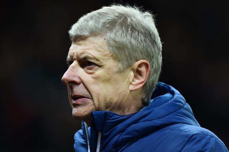 Arsenal manager Arsene Wenger leaves the pitch at the end of his side's Premier League match against Stoke City in Stoke-on-Trent on December 6, 2014 (AFP Photo/Ben Stansall)