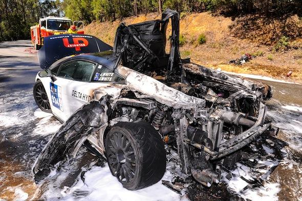 This is the moment a very rare Lamborghini was gutted after catching fire while being raced at more than 120mph. See SWNS story SWLAMBO; Jason White was driving his beloved £300,000 Lamborghini Gallardo Super Trofeo in a difficult road race. And as he negotiated the targa circuit with uncle, John, who was navigating, the Italian supercar suddenly overheated. Huge flames started spewing out of the back of the Lamborghini and they quickly pulled over and jumped out, leaving the car to burn to the ground.