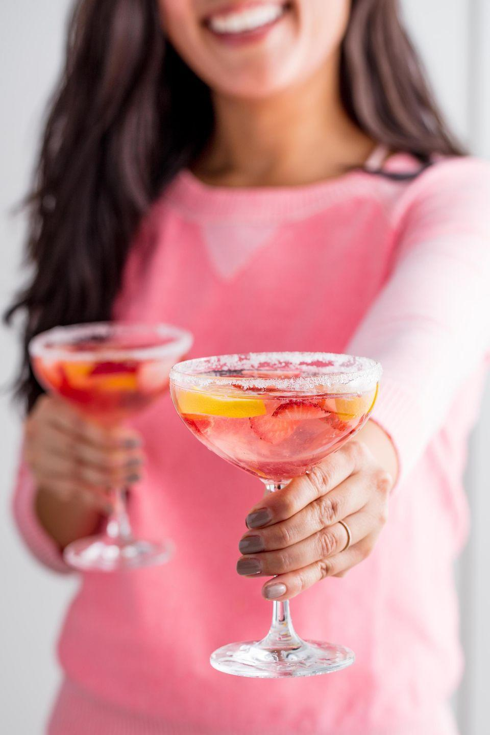 """<p>Moscato, lemonade, and vodka is a winning (and sweet) combo.</p><p>Get the recipe from <a href=""""https://www.delish.com/cooking/recipe-ideas/recipes/a54556/giggle-juice-recipe/"""" rel=""""nofollow noopener"""" target=""""_blank"""" data-ylk=""""slk:Delish"""" class=""""link rapid-noclick-resp"""">Delish</a>.</p>"""