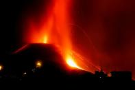 Lava and smoke rise following the eruption of a volcano on the Canary Island of La Palma