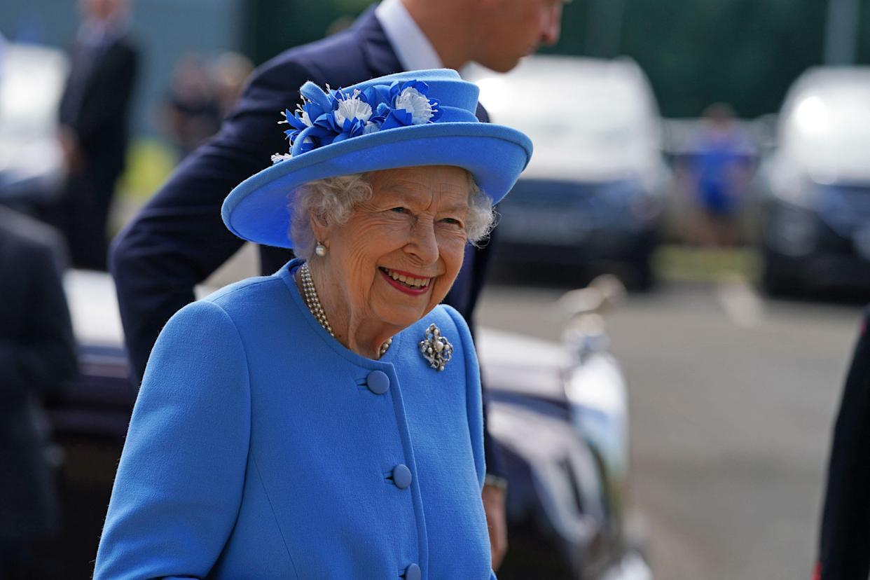 Britain's Queen Elizabeth II smiles as she arrives for a visit to AG Barr's factory in Cumbernauld, east of Glasgow, where the Irn-Bru drink is manufactured on June 28, 2021. - The Queen is in Scotland for Royal Week where she will be undertaking a range of engagements celebrating community, innovation and history. (Photo by Andrew Milligan / POOL / AFP) (Photo by ANDREW MILLIGAN/POOL/AFP via Getty Images)
