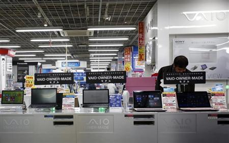 A shopper looks at Sony Corp's Vaio PCs at an electronics retail store in Tokyo