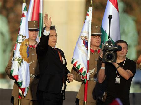 Hungarian Prime Minister Orban waves after his speech at the Heroes Square in Budapest