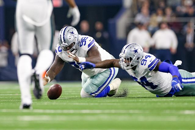 <p>Dallas Cowboys Defensive Tackle Maliek Collins (96) and Defensive End Randy Gregory (94) scramble to recover a fumble during the game between the Philadelphia Eagles and Dallas Cowboys on December 9, 2018 at AT&T Stadium in Arlington, TX. (Photo by Andrew Dieb/Icon Sportswire) </p>