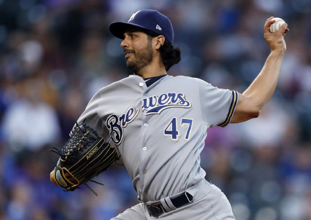 FILE - In this Sept. 28, 2019, file photo, Milwaukee Brewers starting pitcher Gio Gonzalez works against the Colorado Rockies in the first inning of a baseball game in Denver. The Chicago White Sox boosted their starting rotation, agreeing to a $5 million, one-year contract with two-time All-Star Gonzlez that includes a club option for the 2021 season. The deal announced Friday, Dec. 20, 2019, calls for him to earn $4.5 million in salary next season. (AP Photo/David Zalubowski, File)