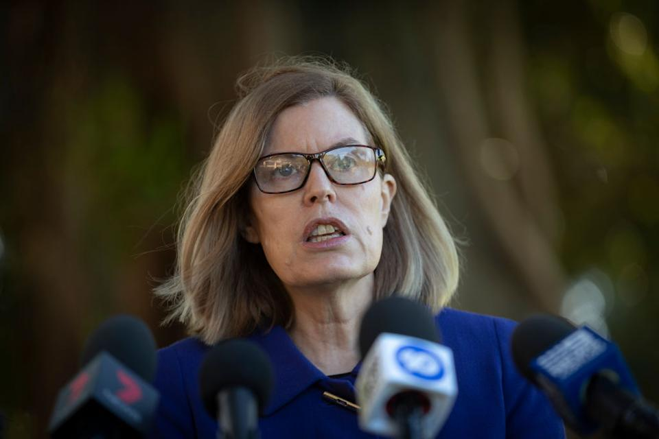 Image of NSW chief health officer Dr. Kerry Chant with media microphones