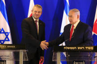Prime Minister of Slovakia Peter Pellegrini, left, shake hands with Israeli Prime Minister Benjamin Netanyahu after their meeting in Jerusalem, Tuesday, Feb. 19, 2019. (AP Photo/Ariel Schalit, Pool)