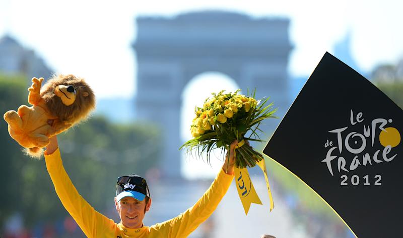 FILE - In this July 22, 2012 file photo, Britain's Bradley Wiggins, winner of the 2012 Tour de France cycling race, poses for photographers on the podium of the Tour de France cycling race in Paris, France. Team Sky said Friday, May 31, 2013 that defending champion Bradley Wiggins will not race in the Tour de France cycling race due to illness and injury. (AP Photo/Jerome Prevost, Pool-File)