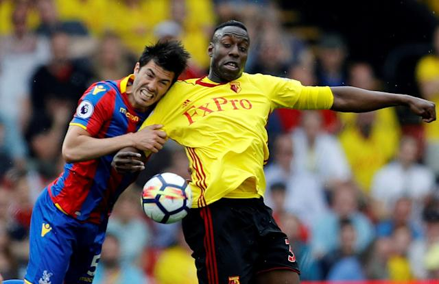 """Soccer Football - Premier League - Watford v Crystal Palace - Vicarage Road, Watford, Britain - April 21, 2018 Watford's Stefano Okaka in action with Crystal Palace's James Tomkins REUTERS/Darren Staples EDITORIAL USE ONLY. No use with unauthorized audio, video, data, fixture lists, club/league logos or """"live"""" services. Online in-match use limited to 75 images, no video emulation. No use in betting, games or single club/league/player publications. Please contact your account representative for further details."""