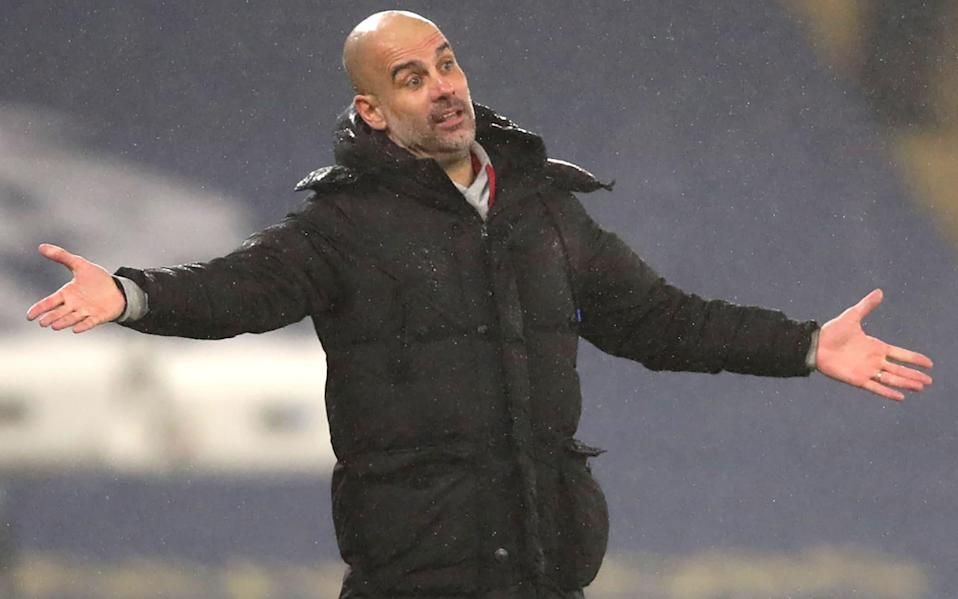 Pep Guardiola gestures to his players from the sidelines - AFP
