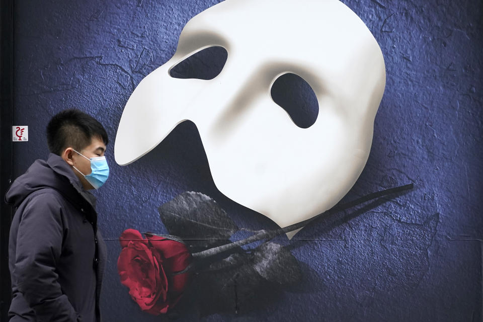 MANCHESTER, UNITED KINGDOM – OCTOBER 20:  A man wears a face mask as he walks pasta a Phantom of the Opera advertisement on October 20, 2020 in Manchester, England. Talks between the Housing and Communities Minister, Robert Jenrick, and the Manchester Mayor, Andy Burnham, collapsed today after they failed to agree a financial package to help Mancunians whose jobs are threatened by a Tier Three lockdown.  (Photo by Christopher Furlong/Getty Images)