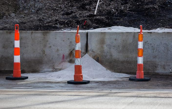 Construction and cleanup at the site of a chemical spill on I-696 in Madison Heights, Monday, Dec. 23, 2019. While the liquid is now cleaned up, there is now an absorbent material at the base of the spill.