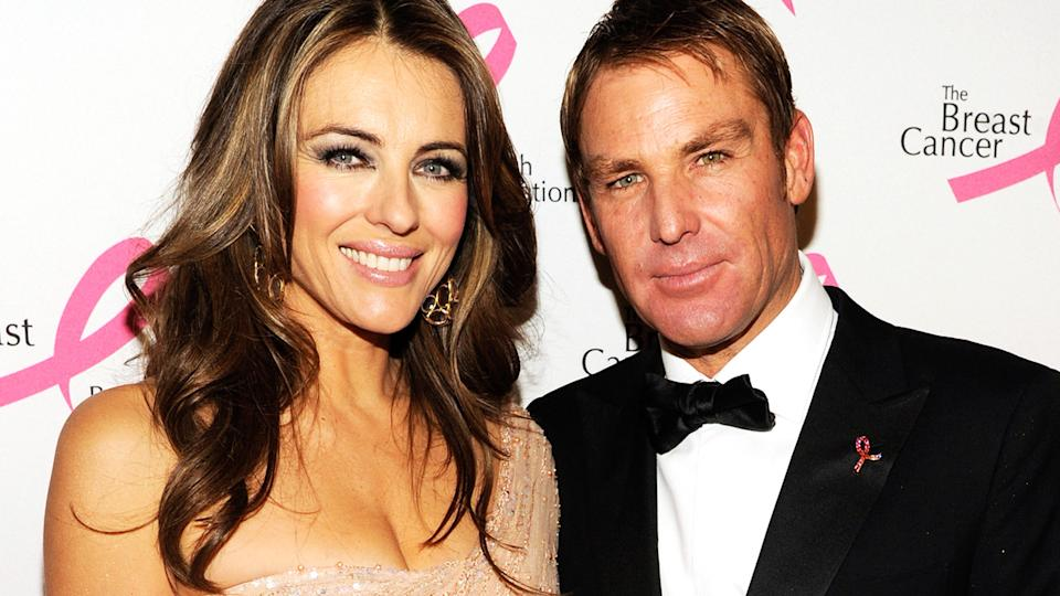 Shane Warne, pictured here with Liz Hurley in 2012.
