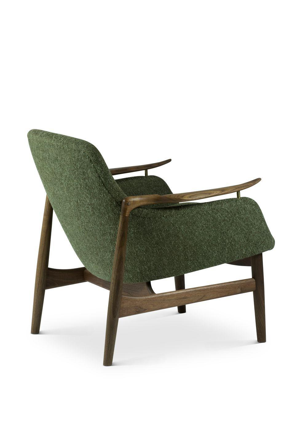 """<p>With its exquisitely carved wooden armrests and inviting shell seat, Finn Juhl's 1953 design is one of his most popular and enduring pieces. Reissued in 2000, its elegant frame looks effortless from all angles. From £5,049, <a href=""""https://finnjuhl.com/"""" rel=""""nofollow noopener"""" target=""""_blank"""" data-ylk=""""slk:finnjuhl.com"""" class=""""link rapid-noclick-resp"""">finnjuhl.com</a></p>"""