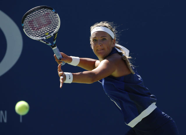 Victoria Azarenka, of Belarus, returns a shot to Christina McHale, of the United States, during the second round of the 2014 U.S. Open tennis tournament, Thursday, Aug. 28, 2014, in New York. (AP Photo/Elise Amendola)