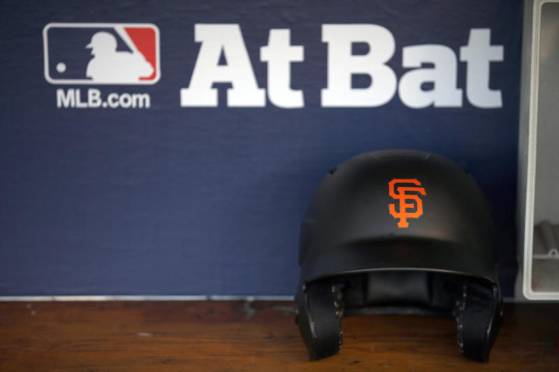 A San Francisco Giants helmet sits in the dugout before Game 2 of baseball's National League Division Series against the Chicago Cubs, Saturday, Oct. 8, 2016, in Chicago. (AP Photo/Nam Y. Huh)