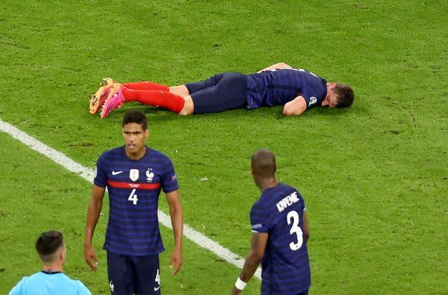 Pavard lies prone on the pitch after his collision with Gosens