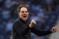 Chelsea's head coach Thomas Tuchel reacts after Chelsea's Kai Havertz scored the opening goal during the Champions League final soccer match between Manchester City and Chelsea at the Dragao Stadium in Porto, Portugal, Saturday, May 29, 2021. (Pierre Philippe Marcou/Pool via AP)