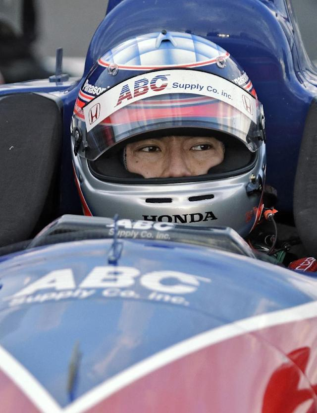 Takuma Sato, of Japan, sits in his car after qualifying for the pole position for the IndyCar Firestone Grand Prix of St. Petersburg auto race Saturday, March 29, 2014, in St. Petersburg, Fla. The race takes place on Sunday. (AP Photo/Chris O'Meara)