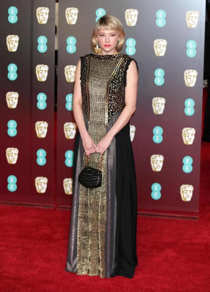 <p>Actress Haley Bennett took to the BAFTA red carpet in a heavily-embellished gold gown and accessorised the look with a miniature handbag and a bold lip. <em>[Photo: Getty]</em> </p>