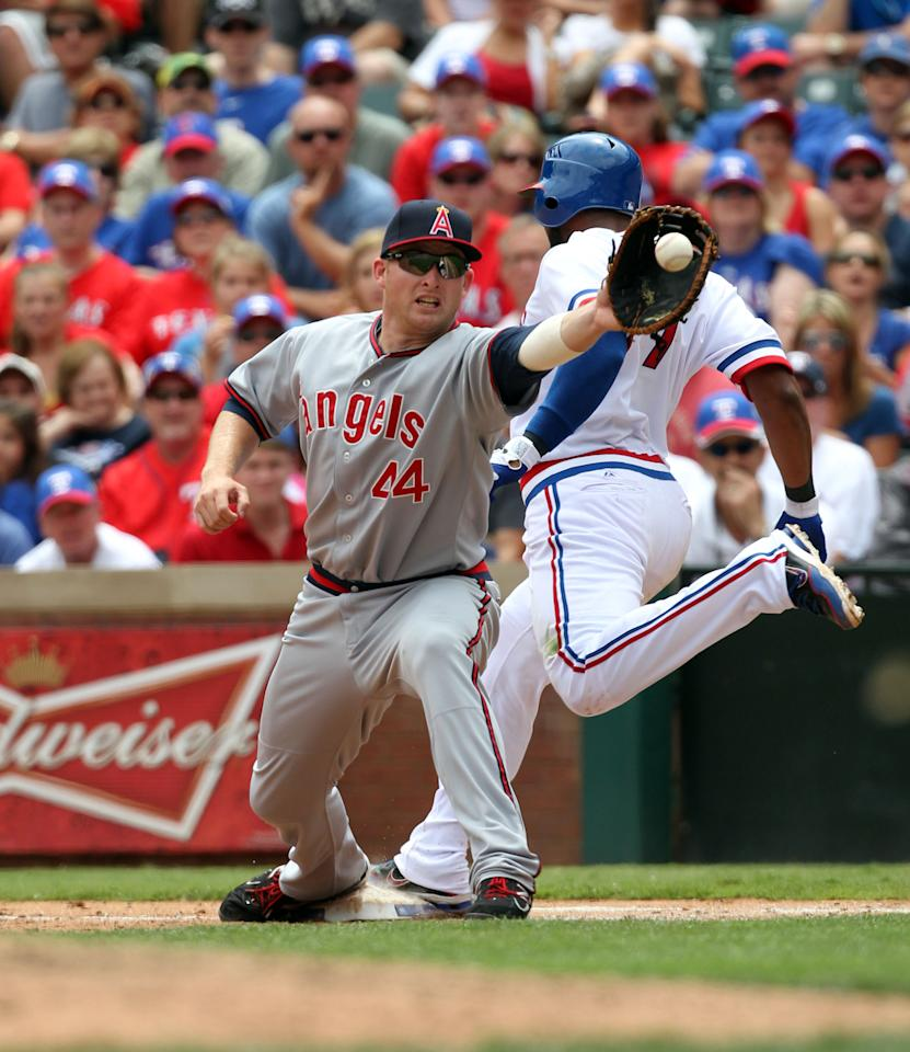 ARLINGTON, TX - MAY 12: Elvis Andrus #1 of the Texas Rangers is called out at first as 1st baseman Mark Trumbo #44 of the Los Angeles Angels of Anaheim fields the throw on May 12, 2012 in Arlington, Texas. The Angels won 4-2. (Photo by Layne Murdoch/Getty Images)
