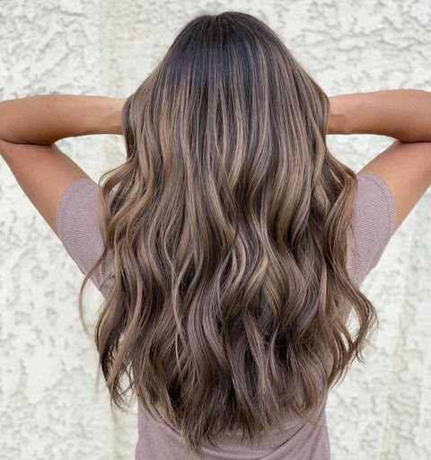 """<p>Just because you want to try ash-brown hair doesn't mean you <em>have</em> to go super dark. This style looks great with a <strong>medium-brown base and silver-toned <a href=""""https://www.cosmopolitan.com/style-beauty/beauty/a32070575/how-to-highlight-hair-at-home/"""" rel=""""nofollow noopener"""" target=""""_blank"""" data-ylk=""""slk:highlights"""" class=""""link rapid-noclick-resp"""">highlights</a></strong>.</p><p><a href=""""https://www.instagram.com/p/CD7ITwShWnx/"""" rel=""""nofollow noopener"""" target=""""_blank"""" data-ylk=""""slk:See the original post on Instagram"""" class=""""link rapid-noclick-resp"""">See the original post on Instagram</a></p>"""