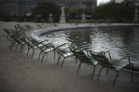 Empty chairs are pictured in the Tuileries gardens Wednesday, Oct.14, 2020 in Paris. French President Emmanuel Macron is giving a nationally televised interview Wednesday night to speak about the virus, his first in months. French media reports say Macron will also step up efforts on social media to press the need for virus protections among young people. (AP Photo/Lewis Joly)